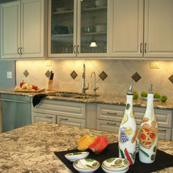 two tone kitchen remodel with under counter microwave drawer in the island. - Daryl Ann Letts, CKD, CAPS
