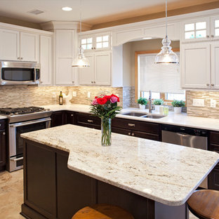 Photo of a mid-sized traditional u-shaped eat-in kitchen in Minneapolis with an undermount sink, raised-panel cabinets, white cabinets, granite benchtops, multi-coloured splashback, matchstick tile splashback, stainless steel appliances, marble floors and with island.