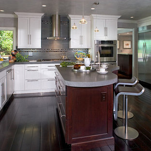 Inspiration for a mid-sized contemporary l-shaped eat-in kitchen in Orange County with shaker cabinets, white cabinets, stainless steel appliances, dark hardwood floors, with island, a double-bowl sink, terrazzo benchtops, grey splashback and porcelain splashback.