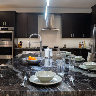 Two-toned full kitchen remodel featuring granite countertops