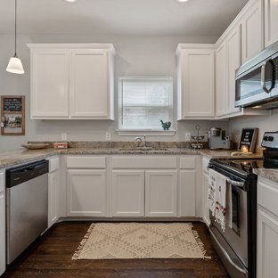 Design ideas for a small contemporary u-shaped kitchen/diner in Other with a built-in sink, shaker cabinets, white cabinets, granite worktops, yellow splashback, marble splashback, stainless steel appliances, dark hardwood flooring, a breakfast bar, brown floors and yellow worktops.