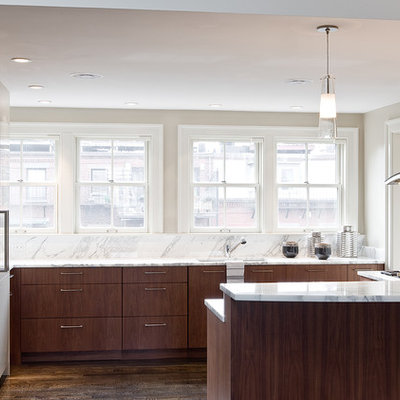 Inspiration for a contemporary u-shaped kitchen remodel in Boston with stainless steel appliances, marble countertops, flat-panel cabinets, dark wood cabinets and marble backsplash