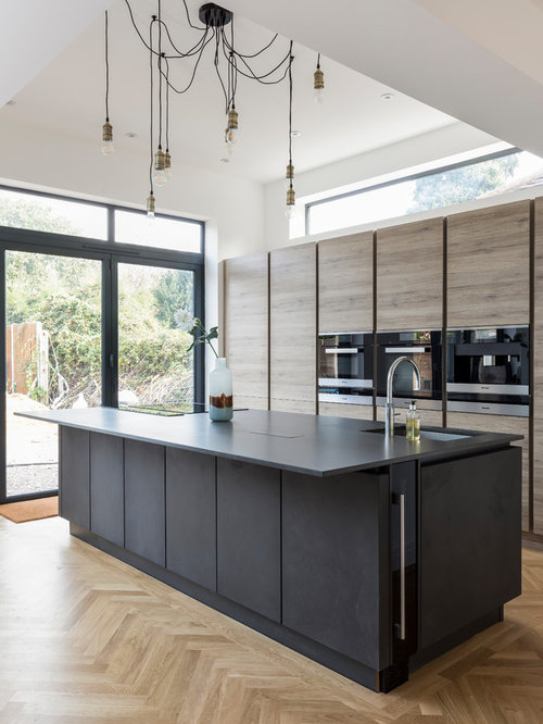 Contemporary Galley Kitchen In Other With A Submerged Sink, Flat Panel  Cabinets, Medium