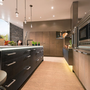 Photo of a large contemporary l-shaped kitchen pantry in Houston with flat-panel cabinets, medium wood cabinets, glass worktops, black splashback, stainless steel appliances, light hardwood flooring and an island.