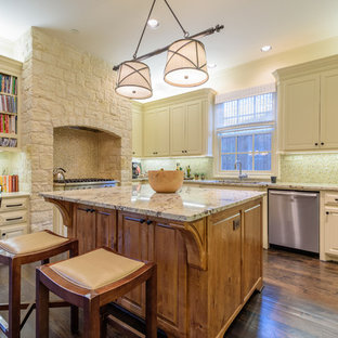 Large traditional eat-in kitchen photos - Eat-in kitchen - large traditional l-shaped dark wood floor and brown floor eat-in kitchen idea in Dallas with an undermount sink, raised-panel cabinets, beige cabinets, granite countertops, multicolored backsplash, ceramic backsplash, stainless steel appliances, an island and multicolored countertops