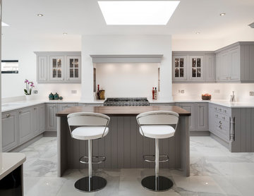 Upcycled grey kitchen with quartz and walnut surfaces