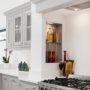 Inspiration for a mid-sized traditional u-shaped open plan kitchen in Other with grey cabinets, quartzite benchtops, stainless steel appliances, marble floors, with island and yellow benchtop.