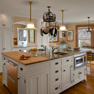 Example of a classic kitchen design in Providence with beaded inset cabinets, granite countertops and white cabinets