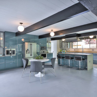 Photo of a large midcentury l-shaped eat-in kitchen in San Francisco with an undermount sink, flat-panel cabinets, blue cabinets, quartz benchtops, stainless steel appliances, concrete floors, with island and grey floor.