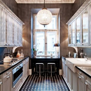 Inspiration for a mid-sized victorian kitchen in New York with porcelain floors, a farmhouse sink, glass-front cabinets, white cabinets, marble benchtops, window splashback, stainless steel appliances and black floor.