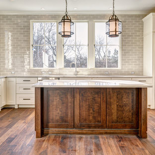 Large transitional open concept kitchen ideas - Inspiration for a large transitional l-shaped medium tone wood floor open concept kitchen remodel in Columbus with shaker cabinets, white cabinets, marble countertops, gray backsplash, subway tile backsplash, stainless steel appliances and an island