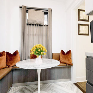 Small midcentury galley eat-in kitchen in New York with an undermount sink, flat-panel cabinets, grey cabinets, soapstone benchtops, white splashback, ceramic splashback, stainless steel appliances, ceramic floors, grey floor, no island and white benchtop.