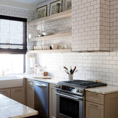 Transitional u-shaped eat-in kitchen photo in New York with a farmhouse sink, marble countertops, white backsplash, stainless steel appliances, beige cabinets, subway tile backsplash and raised-panel cabinets