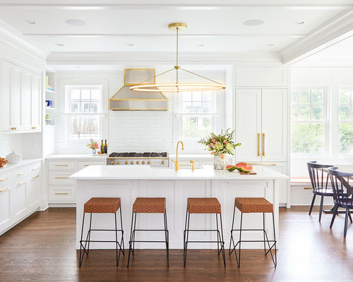 Example Of A Transitional Medium Tone Wood Floor And Brown Eat In Kitchen Design
