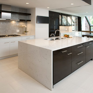 Inspiration for a mid-sized contemporary l-shaped porcelain floor eat-in kitchen remodel in Philadelphia with an undermount sink, flat-panel cabinets, white cabinets, solid surface countertops, gray backsplash, paneled appliances and an island