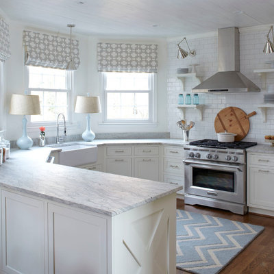 Example of a transitional u-shaped eat-in kitchen design in Atlanta with a farmhouse sink, shaker cabinets, white cabinets, white backsplash, subway tile backsplash, stainless steel appliances and granite countertops