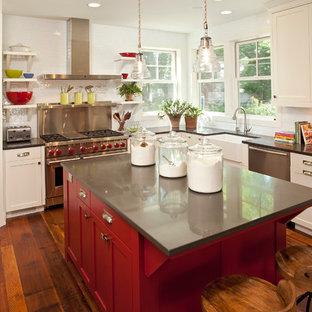 Kitchen - cottage kitchen idea in Minneapolis with white cabinets, white backsplash, subway tile backsplash and stainless steel appliances
