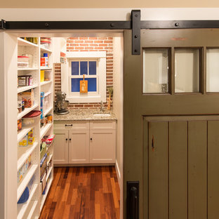 Example of a classic enclosed kitchen design in Denver with an undermount sink, recessed-panel cabinets and beige cabinets