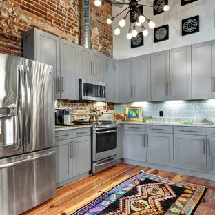 Industrial kitchen ideas - Kitchen - industrial u-shaped medium tone wood floor kitchen idea in Charleston with shaker cabinets, gray cabinets, gray backsplash, subway tile backsplash, stainless steel appliances and multicolored countertops
