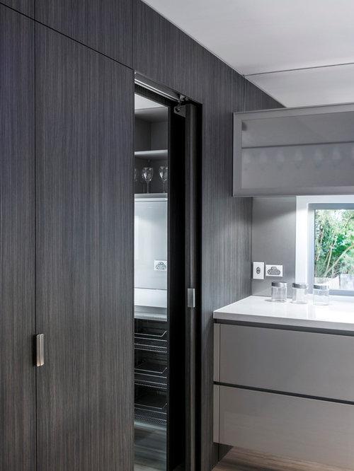 kitchen with glass sheet backsplash and laminate floors