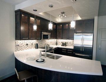 Urban Townhome Kitchen with Espresso Cabinets and White Quartz Counters
