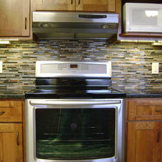Traditional Kitchen by Construction Finishes LLC