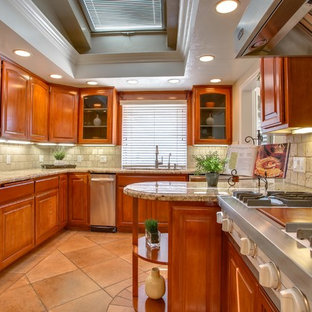 Small midcentury galley separate kitchen in Los Angeles with a double-bowl sink, medium wood cabinets, granite benchtops, beige splashback, ceramic splashback, stainless steel appliances, ceramic floors and multi-coloured floor.