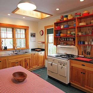 Mid-sized rustic eat-in kitchen photos - Mid-sized mountain style u-shaped black floor eat-in kitchen photo in Portland Maine with a double-bowl sink, open cabinets, medium tone wood cabinets, white appliances, an island, stainless steel countertops and wood backsplash