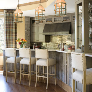 This is an example of a contemporary kitchen in Denver with grey cabinets, metallic splashback and beige benchtop.