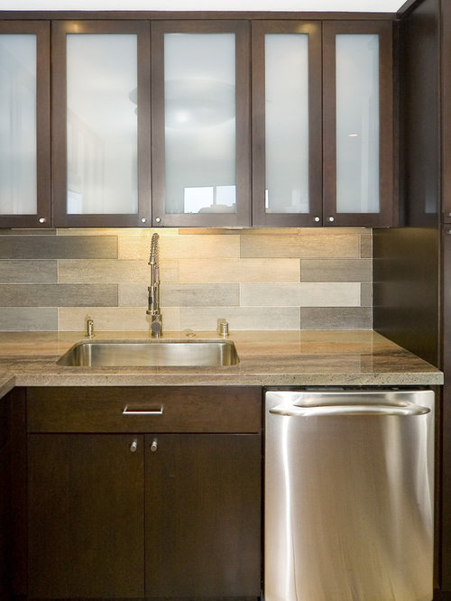 glass front cabinets dark wood cabinets gray backsplash glass tile