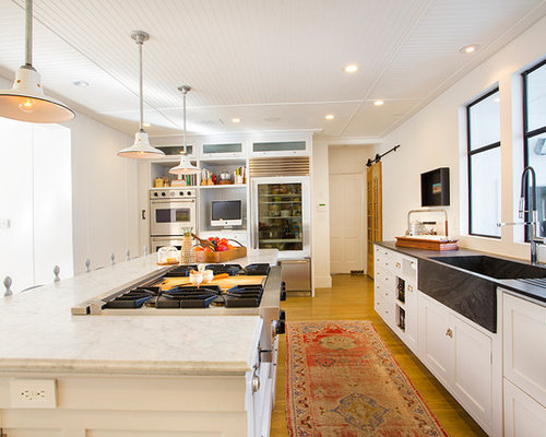 Example Of An Eclectic Kitchen Design In Los Angeles With An Integrated  Sink, Soapstone Countertops