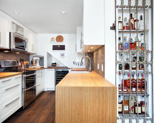 Example Of A Mid Sized Transitional Galley Dark Wood Floor And Brown Enclosed Kitchen