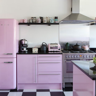Contemporary kitchen in Other with flat-panel cabinets, coloured appliances, an island and multi-coloured floors.