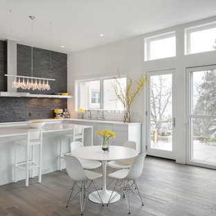 Inspiration for a contemporary kitchen/diner in Portland with flat-panel cabinets, white cabinets, grey splashback and slate splashback.