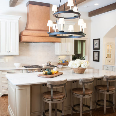 Example of a classic kitchen design in Birmingham with raised-panel cabinets, white cabinets and white backsplash