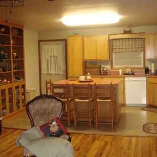 Photo of a mid-sized traditional u-shaped eat-in kitchen in Other with a drop-in sink, flat-panel cabinets, light wood cabinets, quartz benchtops, white appliances, vinyl floors, with island, beige floor and pink benchtop.