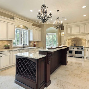 Photo of a large traditional u-shaped eat-in kitchen in Orange County with beaded inset cabinets, distressed cabinets, granite benchtops, beige splashback, cement tile splashback, stainless steel appliances, porcelain floors, with island and an undermount sink.