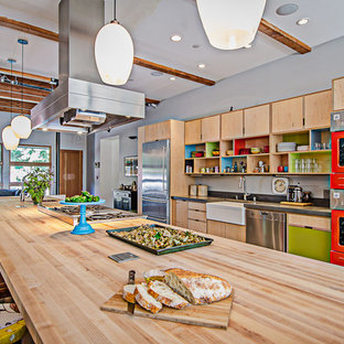 Industrial galley kitchen in Seattle with a farmhouse sink, wood benchtops, open cabinets, light wood cabinets and coloured appliances.