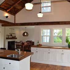 Rustic Kitchen by Nashawtuc Architects, Inc.