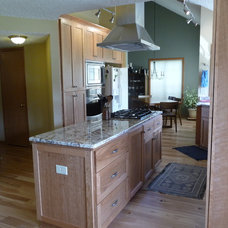Traditional Kitchen Vaulted Kitchen with hickory floors, cherry cabinets, steel and black appliances