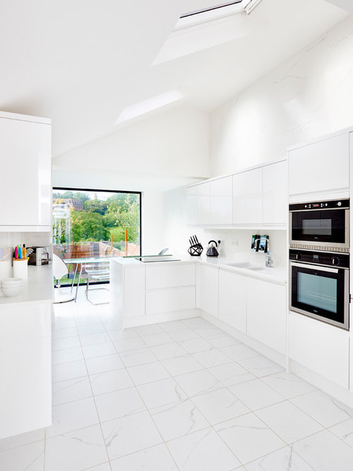 Inspiration For A Contemporary And Modern Kitchen/diner In Devon With  Flat Panel Cabinets