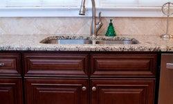 Venetian Ice Granite On Dark Wood Cabinets