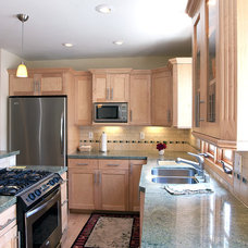 Traditional Kitchen by Mega Builders