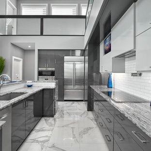 Design ideas for a mid-sized contemporary kitchen in Edmonton with an undermount sink, louvered cabinets, grey cabinets, quartz benchtops, white splashback, subway tile splashback, stainless steel appliances, porcelain floors, with island, grey floor and grey benchtop.