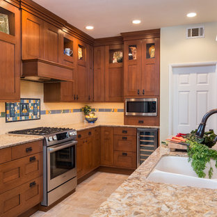 Mid-sized craftsman kitchen ideas - Mid-sized arts and crafts beige floor kitchen photo in Los Angeles with an undermount sink, shaker cabinets, medium tone wood cabinets, multicolored backsplash, stainless steel appliances, a peninsula and subway tile backsplash