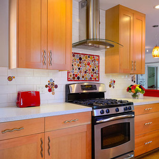 Mid-sized midcentury galley eat-in kitchen in Los Angeles with an undermount sink, recessed-panel cabinets, light wood cabinets, quartz benchtops, multi-coloured splashback, ceramic splashback, stainless steel appliances, cork floors and no island.