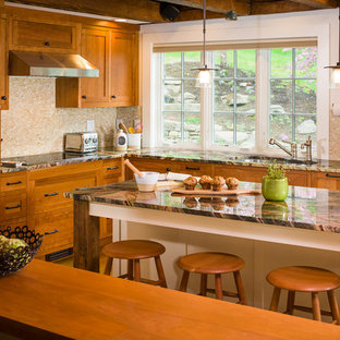 Mid-sized arts and crafts l-shaped medium tone wood floor eat-in kitchen photo in Boston with beige backsplash, an island, a double-bowl sink, shaker cabinets, medium tone wood cabinets, mosaic tile backsplash, marble countertops and paneled appliances