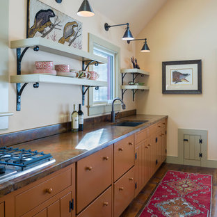 Inspiration for a country single-wall open plan kitchen in Burlington with shaker cabinets, orange cabinets and concrete benchtops.