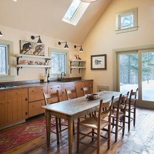 Country single-wall open plan kitchen in Burlington with shaker cabinets, orange cabinets and concrete benchtops.