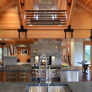 Rustic open concept kitchen pictures - Open concept kitchen - rustic open concept kitchen idea in Burlington with an undermount sink, stainless steel cabinets and stainless steel appliances